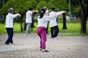 Chinese citizens practicing Tai Chi in the park