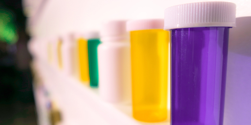 Empty prescription bottles displayed on a shelf
