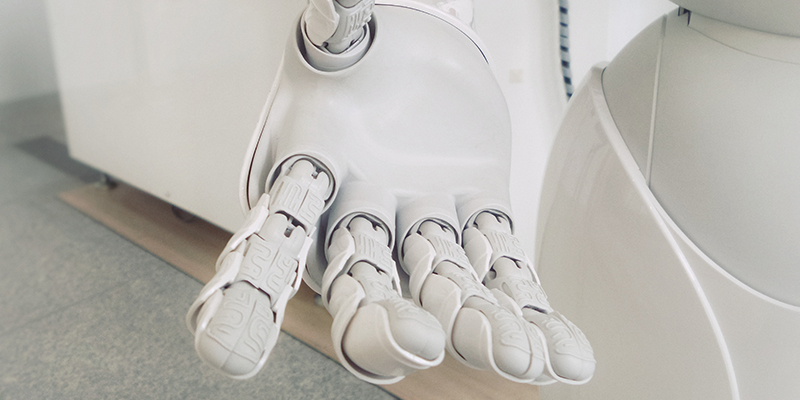 Robot extending hand out with fingers open