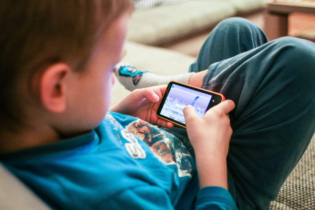 Child playing on a smartphone
