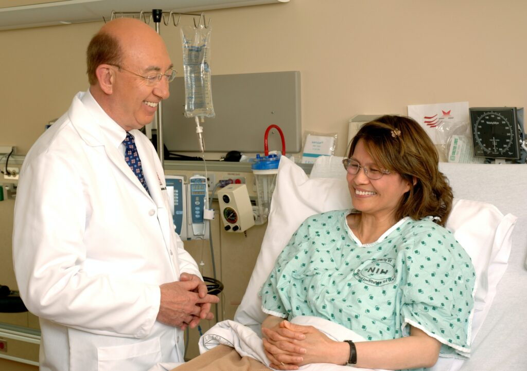 doctor next to patient's bed
