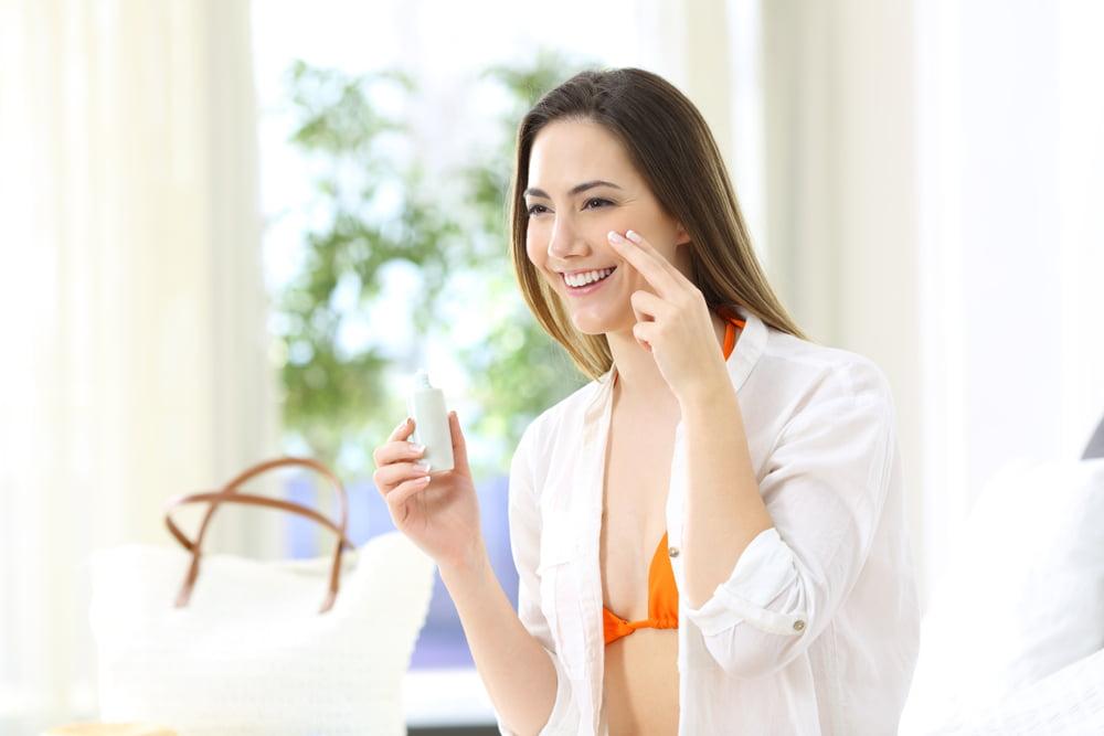 applying sunscreen inside